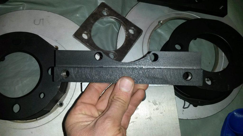 The bracket for the rear passenger side caliper