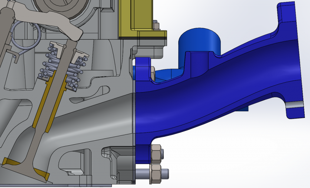 Section view of the manifold mated to the cylinder head, showing the smooth transition and constantly decreasing cross section of the runner